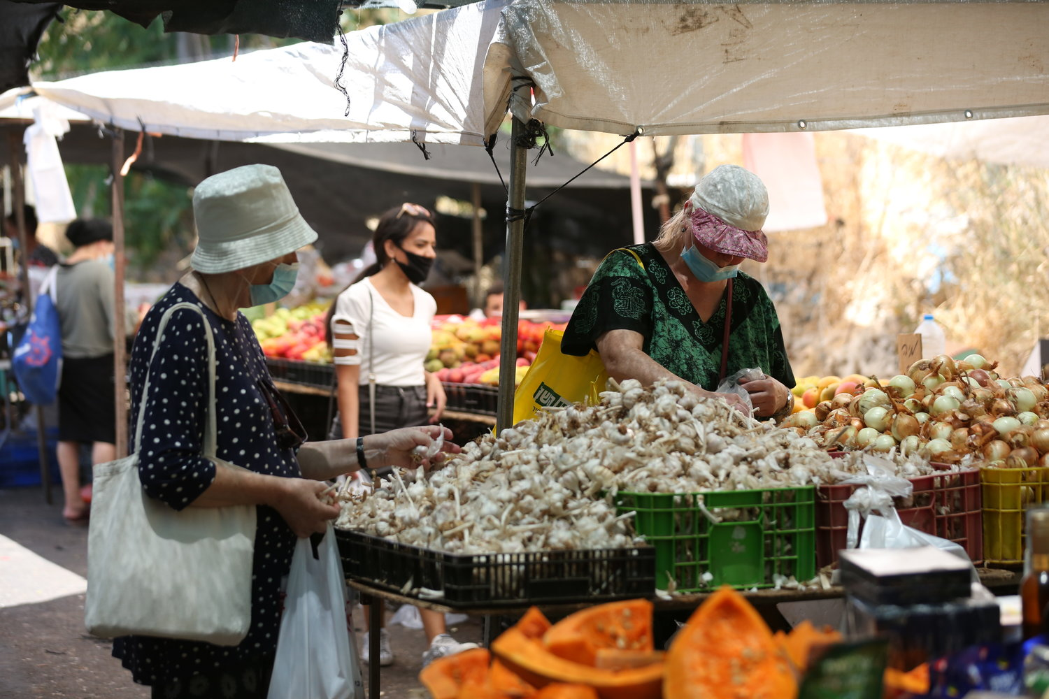 Shoppers are back at Israeli outdoor markets, such as this one in Tzfat, pictured July 15, 2020, but Delicious Experiences lives on.