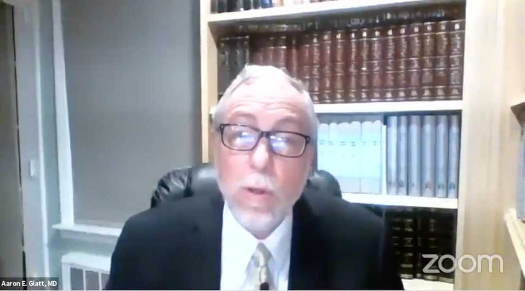 Rabbi Dr. Aaron Glatt, an epidemiologist and rabbi,  giving his weekly COVID update on Zoom.