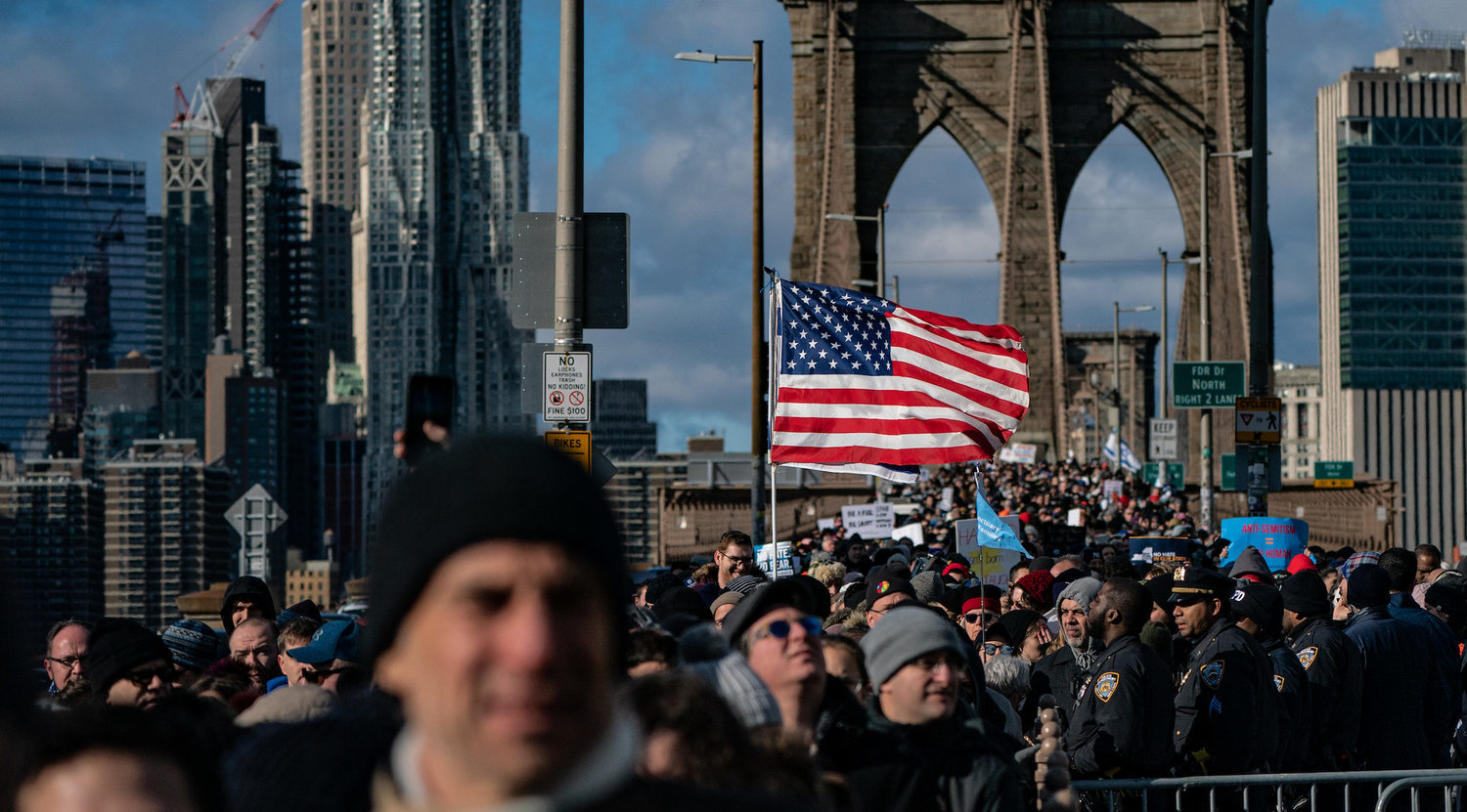 NEW YORK, NY - JANUARY 05: People participate in a Jewish solidarity march across the Brooklyn Bridge on January 5, 2020 in New York City. The march was held in response to a recent rise in anti-Semitic crimes in the greater New York metropolitan area. (Photo by Jeenah Moon/Getty Images)