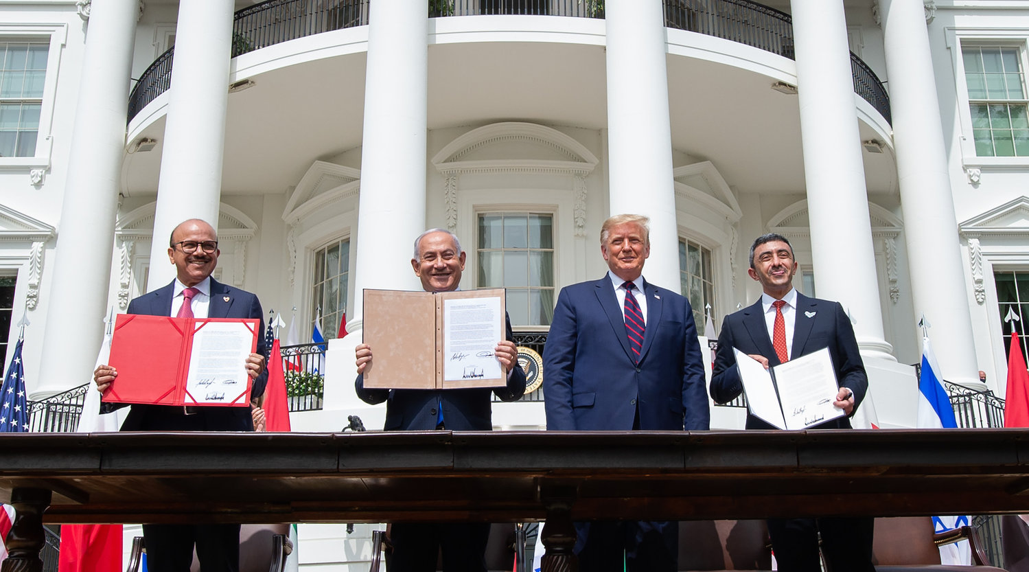 (L-R)Bahrain Foreign Minister Abdullatif al-Zayani, Israeli Prime Minister Benjamin Netanyahu, US President Donald Trump, and UAE Foreign Minister Abdullah bin Zayed Al-Nahyan hold up documents after participating in the signing of the Abraham Accords where the countries of Bahrain and the United Arab Emirates recognize Israel, at the White House in Washington, DC, September 15, 2020. - Israeli Prime Minister Benjamin Netanyahu and the foreign ministers of Bahrain and the United Arab Emirates arrived September 15, 2020 at the White House to sign historic accords normalizing ties between the Jewish and Arab states. (Photo by SAUL LOEB / AFP) (Photo by SAUL LOEB/AFP via Getty Images)