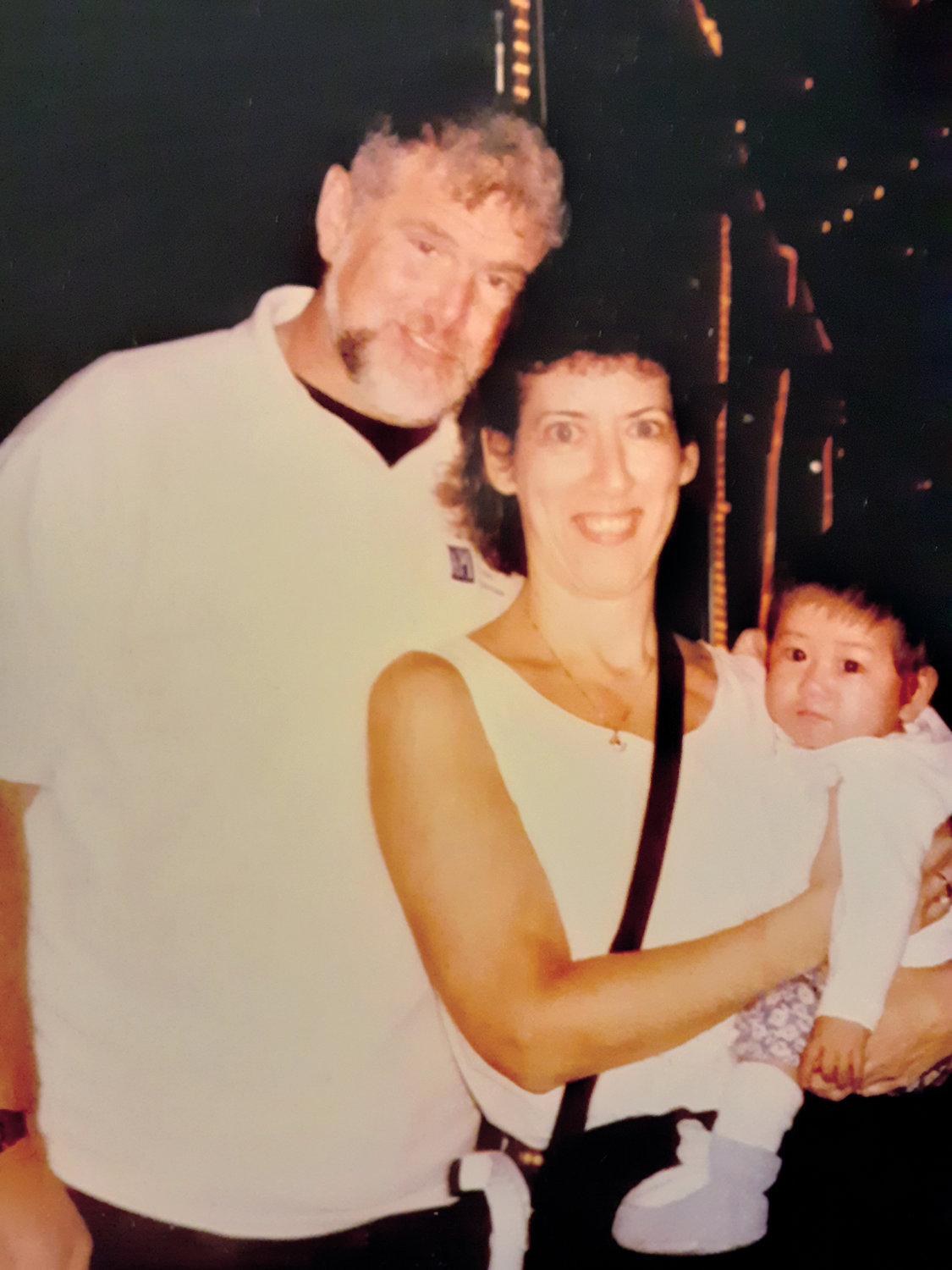 Larry Kessler and Lynne Cains with their then 15-month-old daughter Arianna Kessler during their 1997 trip to China, where they adopted her.