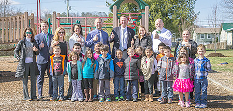 The Allan Jones Foundation recently donated sixteen October red maple trees to Blythe-Bower Elementary School. Pictured from left are Amy Banks, Cleveland Tree Board; Will Jones, Vice President, Jones Management Services; Katie Simpkins, Blythe-Bower teacher and fiancee of Will Jones; Prisavia Croft, Assistant Principal; Principal Joel Barnes; Toby Pendergrass, Director of the Allan Jones Foundation; Amy Hicks, Blythe-Bower parent involvement coordinator; the late Mark Grissom, Vice President of Promotions for Check Into Cash; and Brandi Mason, PTO President.