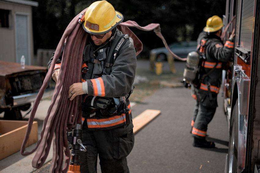 KPFD Firefighter Todd Vanscoyk wraps following a training exercise