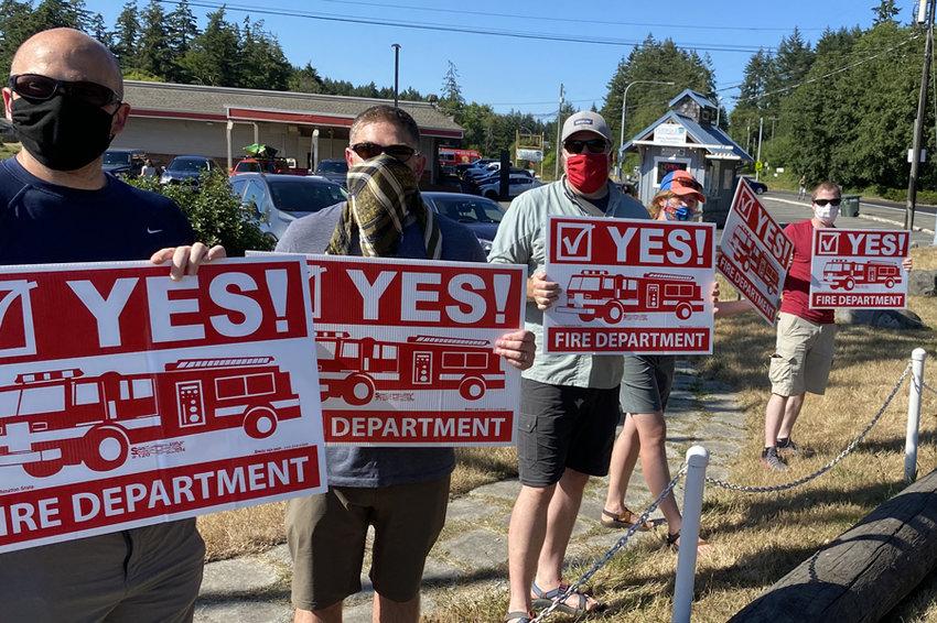 KPFD's Brandon Hagen, Chris Hagen, Jason Learned, Michelle Learned and Tim Davis encouraging voters July 15 at Purdy