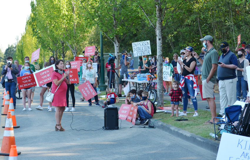 Office of Superintendent of Public Instruction candidate Maia Espinoza speaks at a rally to fully reopen schools Aug. 13 across from the construction site of Elementary No. 9 on Harbor Hill Drive in Gig Harbor.