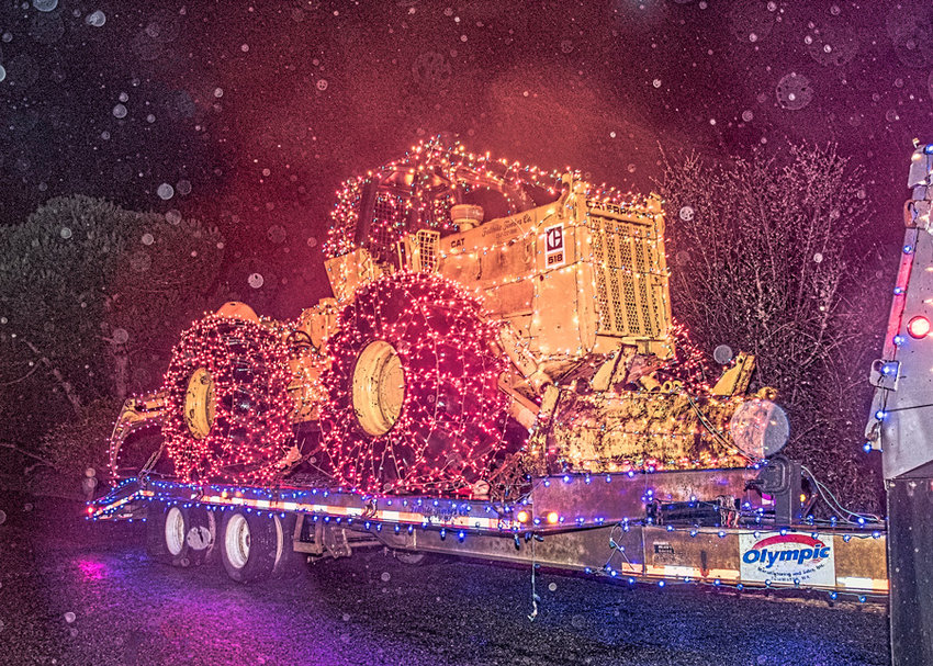 Logger John Jaggi's big toy on tour in the First Annual Home Parade of Lights.