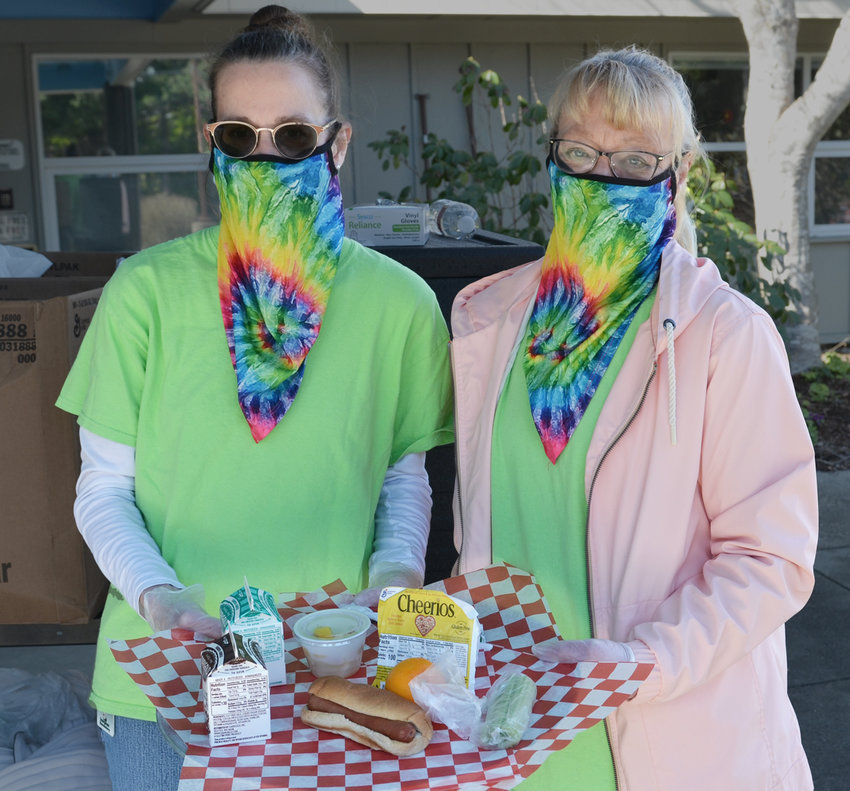 Evergreen Elementary lunch ladies Debbie Ehrhardt (left) and Carmen Carter.