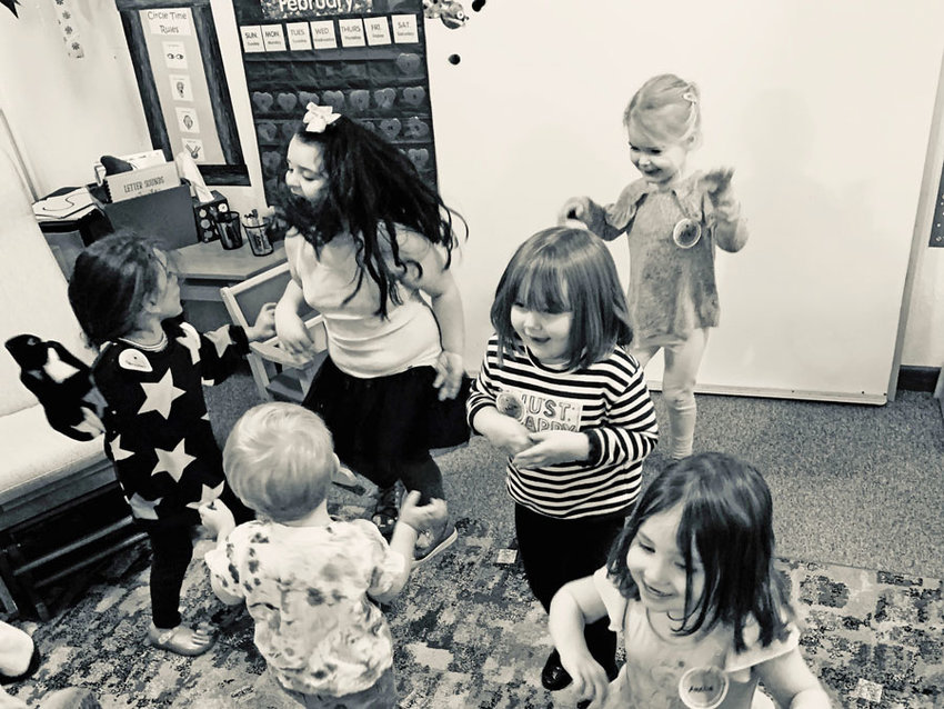 """Preschool students enjoy a dance party in February 2020, before """"social distancing"""" came along."""