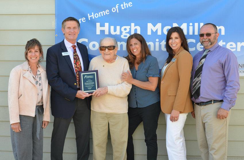 Hugh McMillan center, with school board directors Lori Glover, David Olson, Deborah Krishnadasan, Natalie Wimberley and Chuck West.