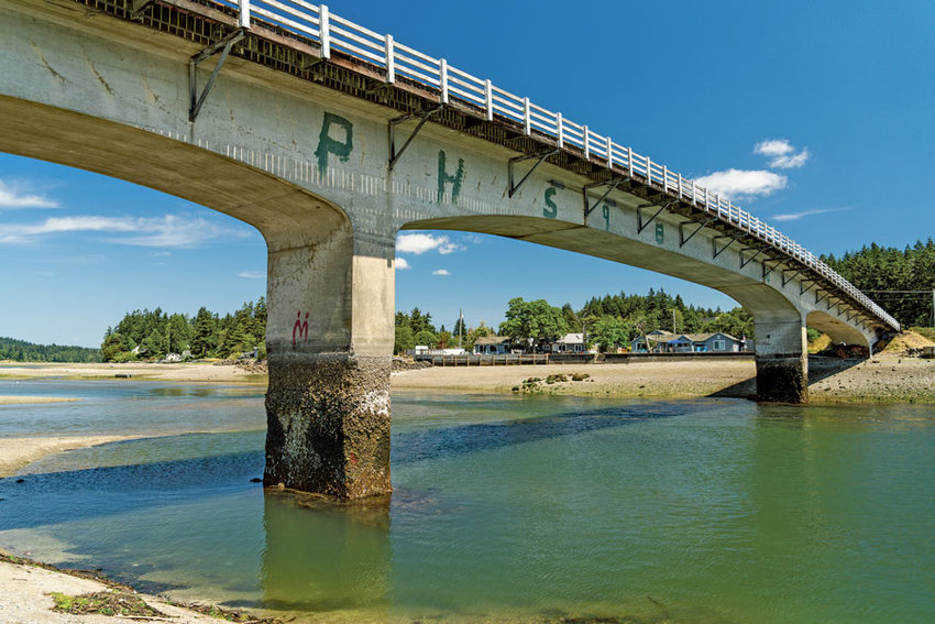 """Built in 1936, the Purdy Bridge is graded as """"poor condition"""" by WSDOT. Concrete pier deterioration seen here at low tide is slated for repair this summer."""