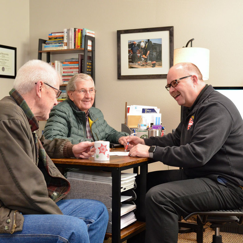 Fire Commissioners Stan Moffett and Frank Grubaugh meet with the Chief.