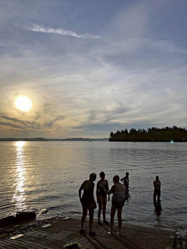 Early morning swimmers meet on Von Geldern Cove.