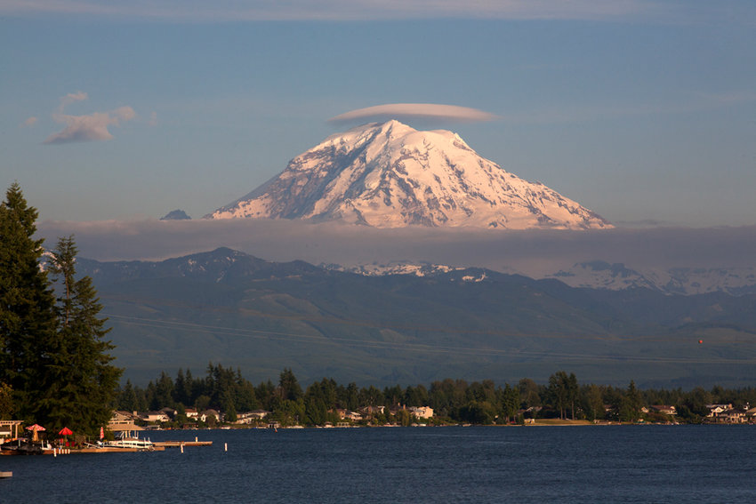"""Mount Rainier or T'qo'bəd sometimes wears a """"hat,"""" which meant to Native people that a weather change could be expected."""