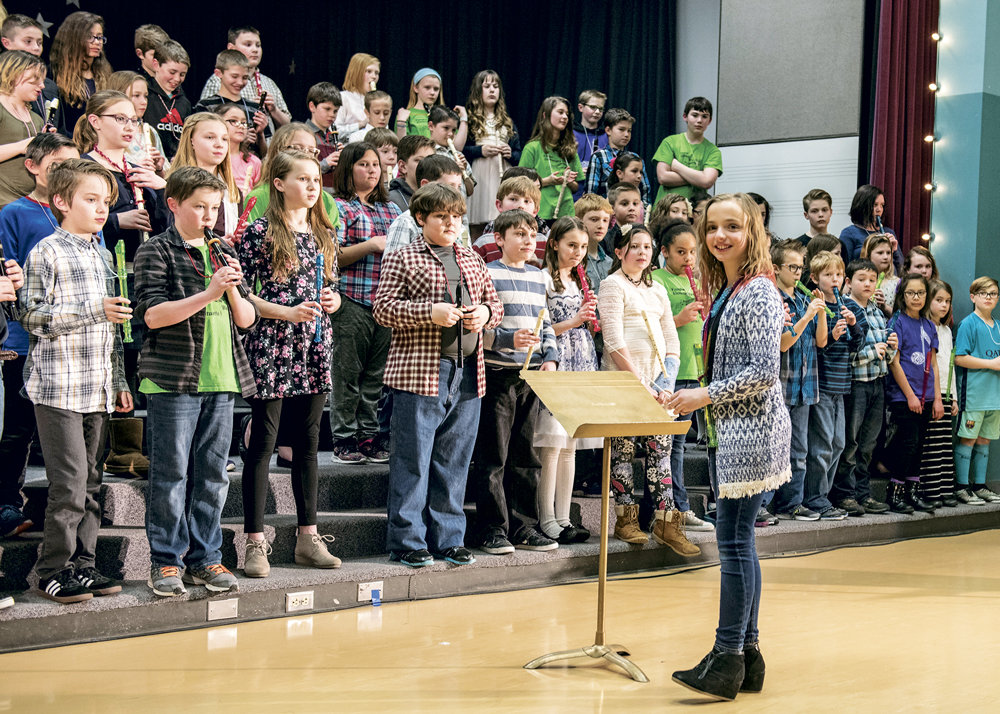 Woodwind maestro Maris Johnson leads the recorder section during a Vaughn Elementary School musical showcase March 9. Photo: Ed Johnson, KP News
