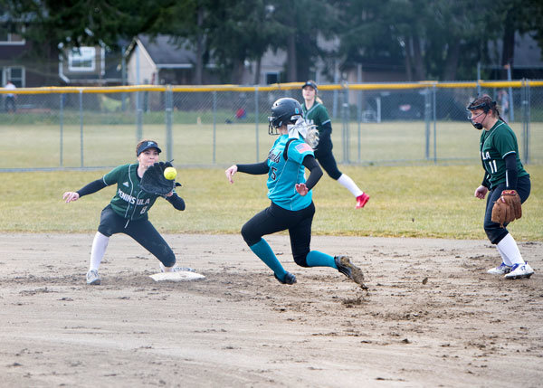 Peninsula Seahawks shortstop Ashley Gonsalves makes the play in a fast-pitch softball game against Spanaway Lake High, but Peninsula lost 10-0. Photo: Ed Johnson, KP News