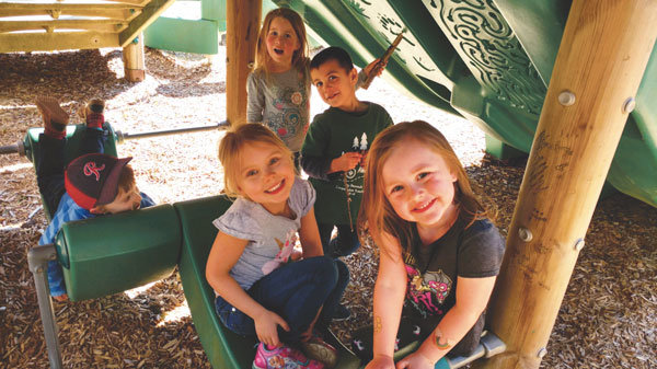 KP Co-op Preschool children at play after school at Home Park. Back from left: Mason Erwin, Elise Gingerich, Colton Kienast; front from left: Grace Maynard, Addison Phillips. Photo: Crystalann Kienast