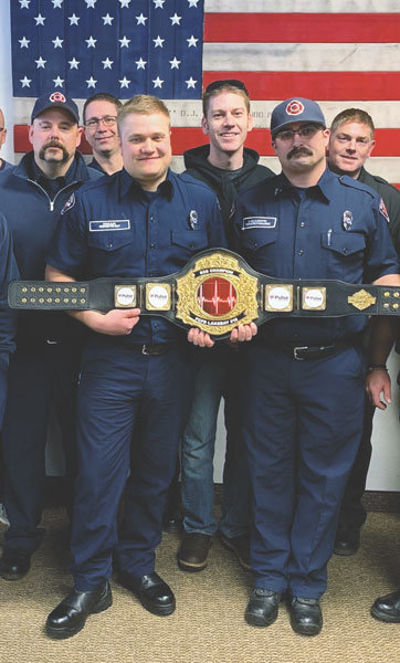 KP firefighter Evan Aas, left, and firefighter/paramedic Doug Gelsleichter received The Pulse Heart Institute Award in March for fastest door-to-procedure delivery time in 2018. A Palmer Lake patient went into cardiac arrest during transport to Tacoma General, but because the crew recognized and advised the hospital of the severity of the situation only 11 minutes elapsed between arrival and clearing the patient's blocked artery. Photo: Anne Nesbit
