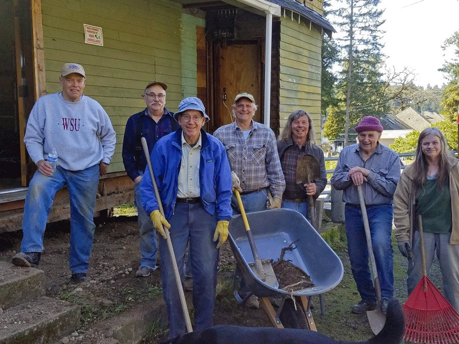 Volunteers of the KP Historical Society hard at work on restoration of the Vaughn Library Hall. Photo: Jackie Hickey