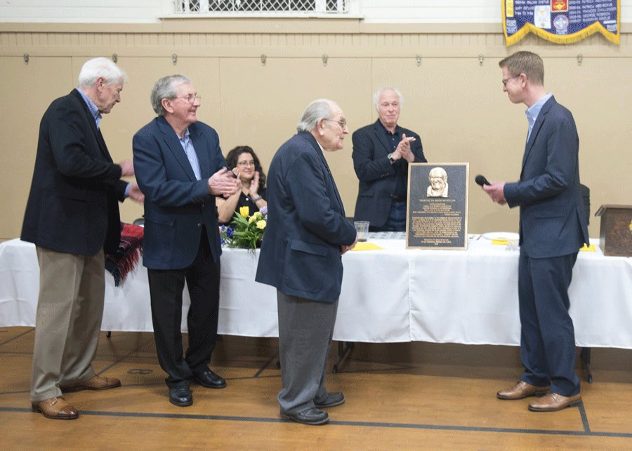 "Hugh McMillan, left, with keynote speaker Jud Morris, center, was honored by U.S. Rep. Derek Kilmer, right, and the KP Fire Commission at the Lions Club Citizen of the Year Award celebration March 30 with a bronze plaque bearing his likeness as thanks for his many good works on behalf of the Key Peninsula over more than three decades. McMillan has earned many such honors in the past, including the Gig Harbor Chamber of Commerce Citizen of the Year Award in 2010; having the occasion of his 90th birthday read into the U.S. Congressional record in 2016; enjoying April 22, 2006 as an official ""Hugh McMillan Day"" proclaimed by the Pierce County Council; and loaning his name to the Hugh McMillan Award given by the Peninsula School District to deserving volunteers. Photo: Ed Johnson, KP News"