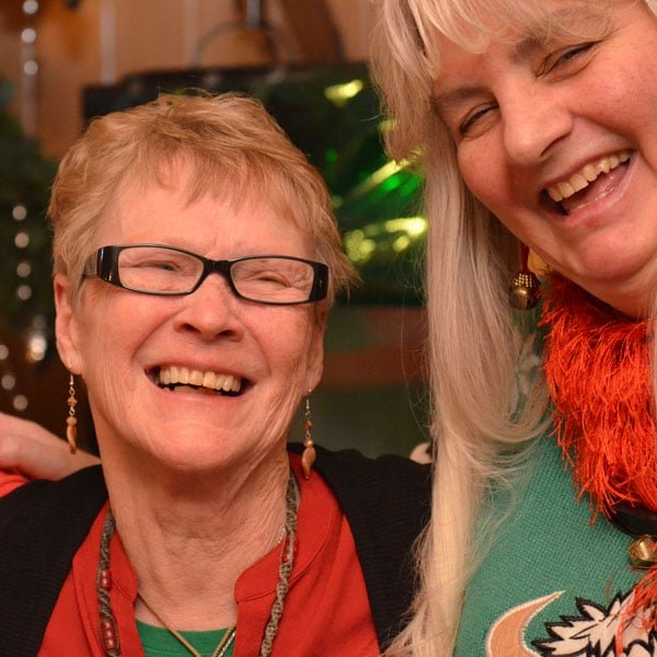 Lulu Smith and Rhonda Honda celebrate the last Christmas party at Lulu's Homeport. Photo: Lisa Bryan, KP News