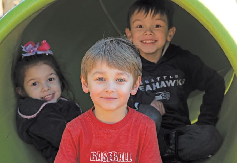 Hailey, Grayson and Ryan in mouth of slide at Gateway Park. Photo: Richard Miller, KP News