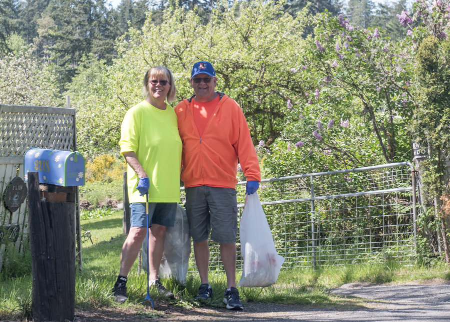 Diana and Jim Craig put their daily walk to good use picking trash along the KP Highway. Photo: Ed Johnson, KP News