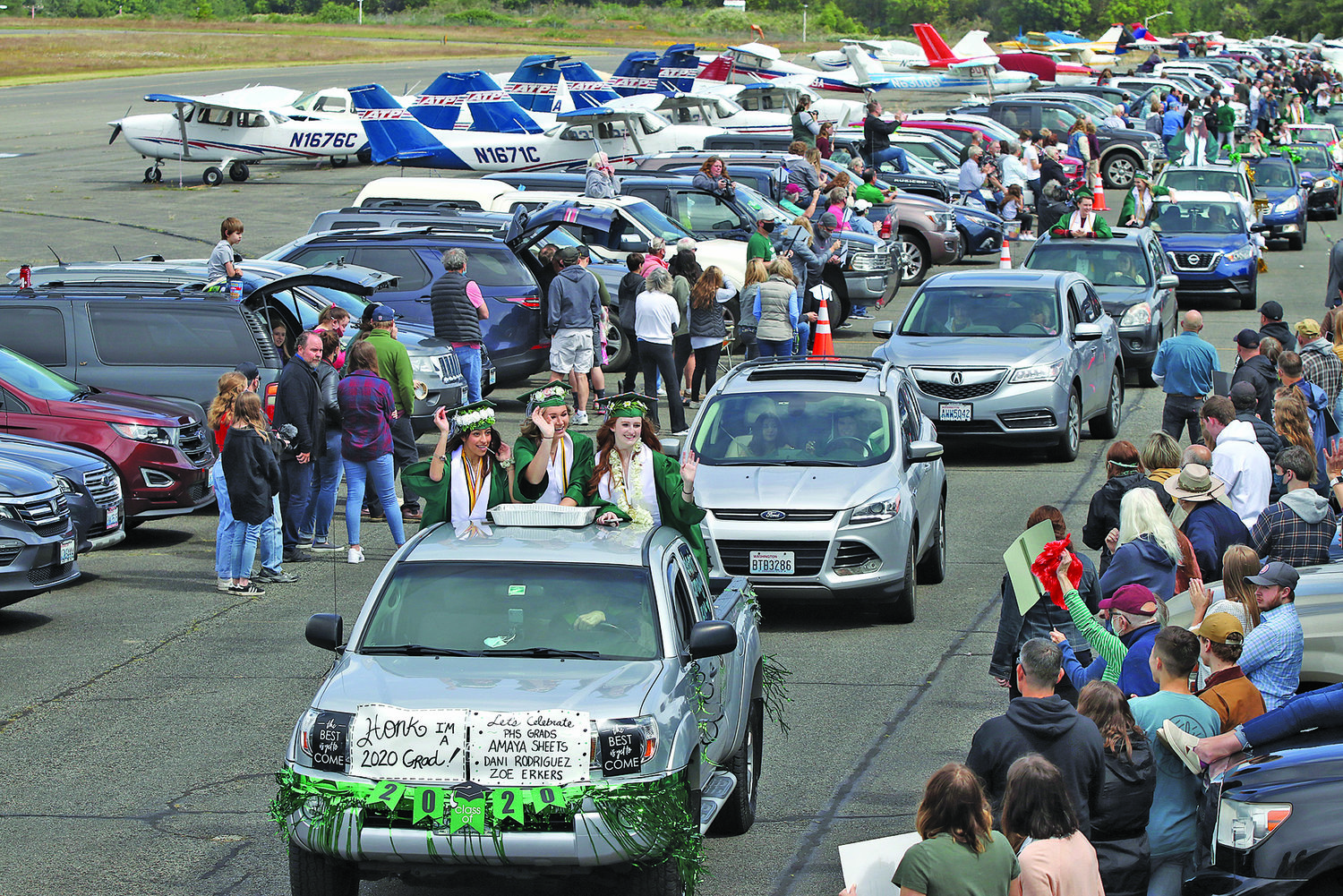 The Peninsula High School graduation parade at the Narrows Airport in Gig Harbor on Saturday, June13, 2020.