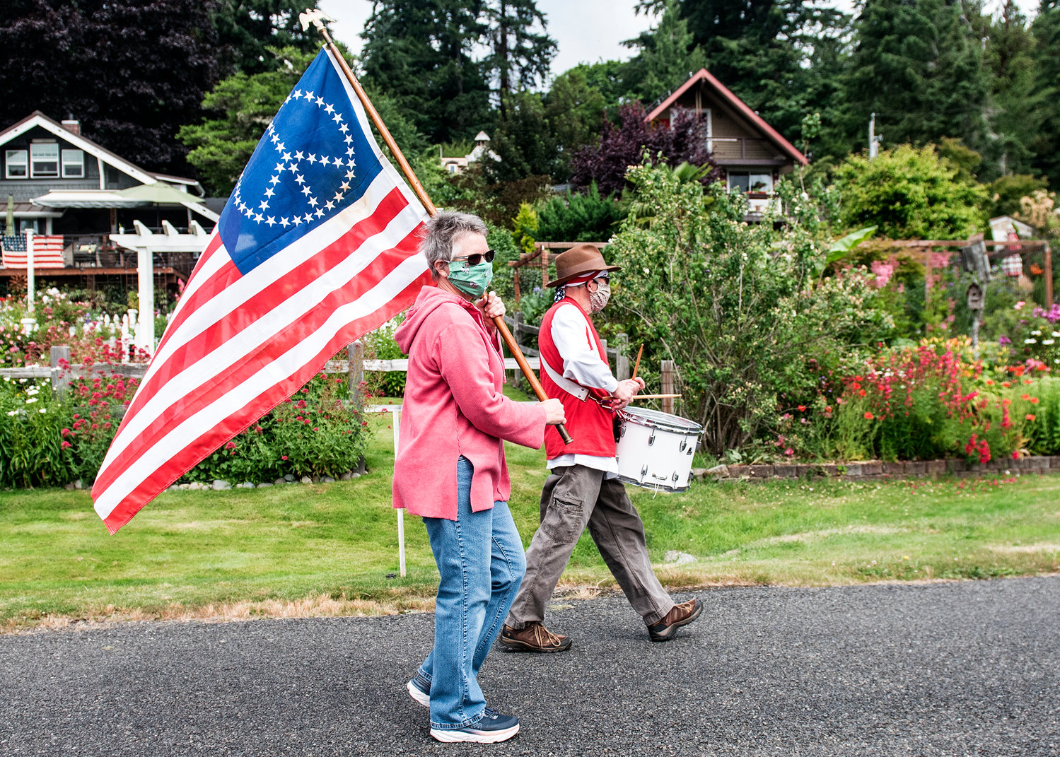 A scaled-back Fourth of July parade in Home, where roughly a third of the participants wore masks.