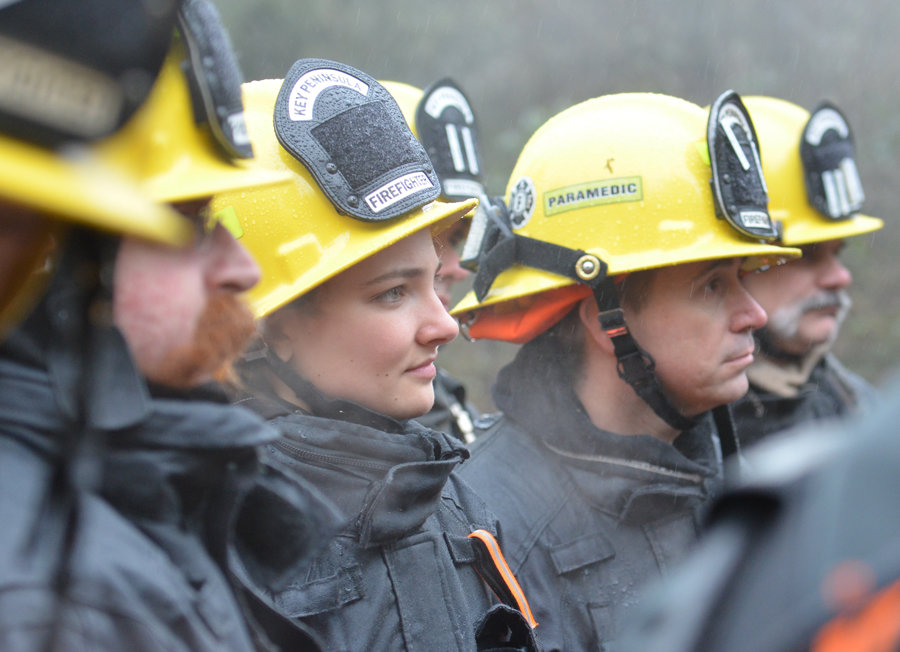 Volunteer firefighter April Lawson listens.