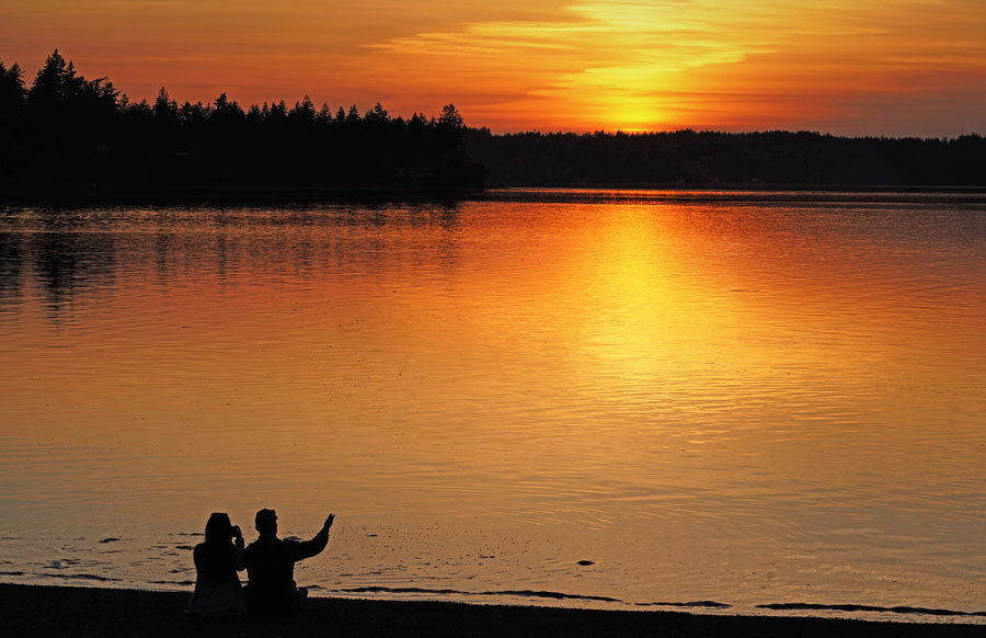 A couple enjoys sunset along Case Inlet.