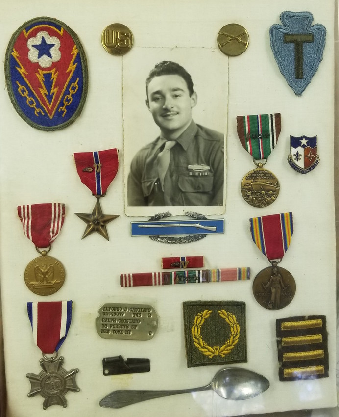 Phyllis placed Caggiano's medals in a display case more than 50 years ago, including a small silver spoon Caggiano found in a kitchen drawer in Italy, which he carried throughout his time in Europe.