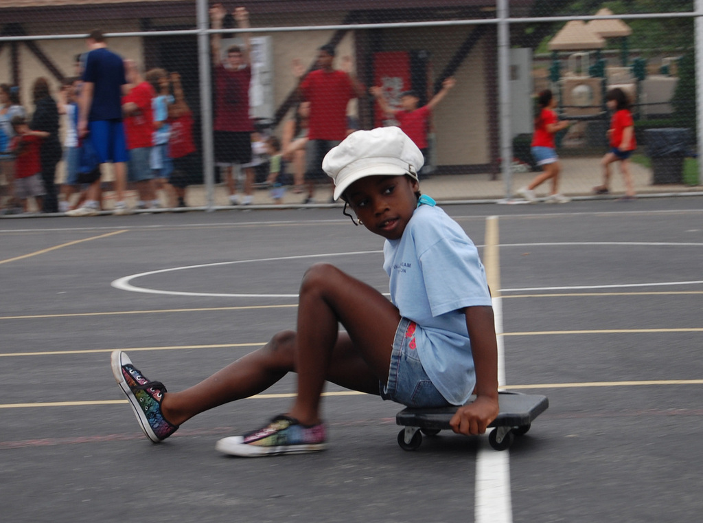 Shanice Manning takes part in the scooter race,  trying  to earn points for the blue team. It was the red team, however, which was declared the winner of the Color Wars.