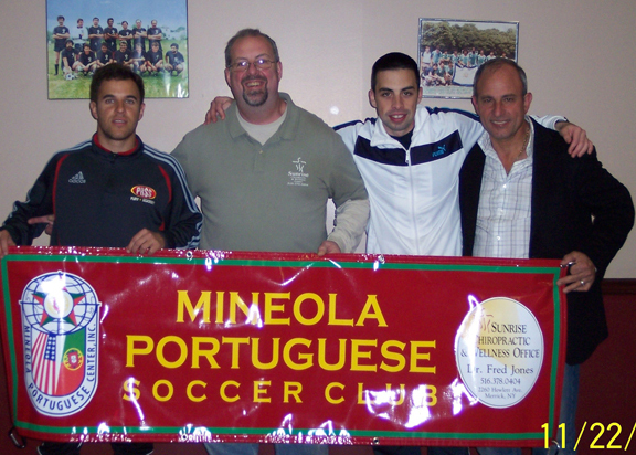 Dr. Fred Jones, second from left, with members of the Mineola Portugese Soccer Club.