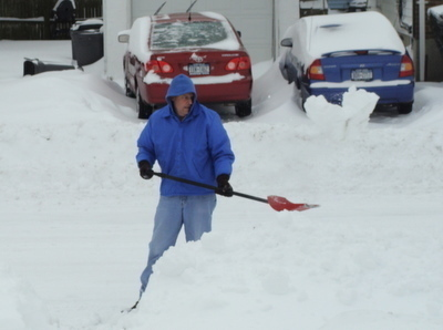 Homeowners shoveled snow from their sidewalks when they awoke to more than a foot of accumulation Sunday morning.