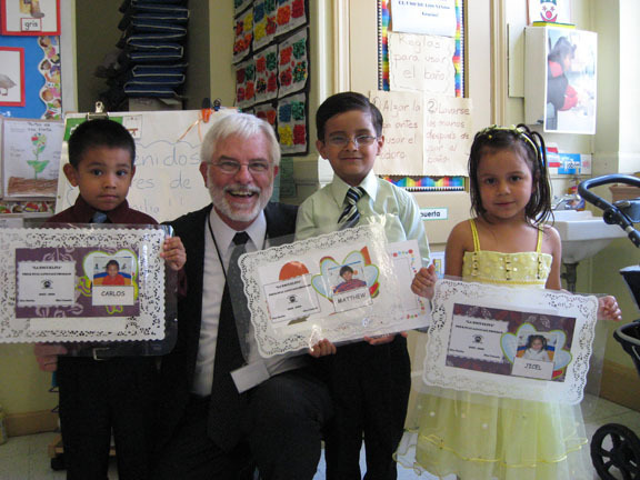 James Harnett, CEO of Family & Children's Association, headquartered in Mineola, is pictured here sharing some fun time with some of his youngest clients.