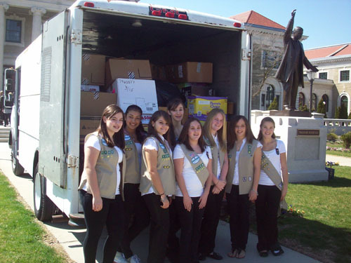 Cadets from Girl Scout Troop No. 1108, out of Salisbury, proudly shipped off their collection of goods to help children in Haiti.