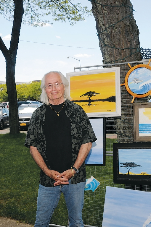 Robert McAuley displayed his paintings at Art in the Plaza last Sunday.