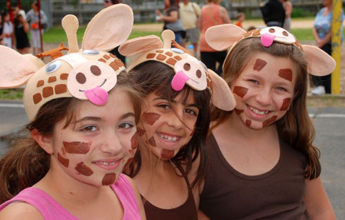 Jessica Mistretta, left, Emilee Hearst, and Cassie Araujo stuck their necks out to dress as giraffes.