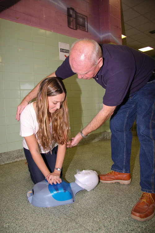 Kayla Babbush and Kevin O'Hara demonstrate CPR for the class.