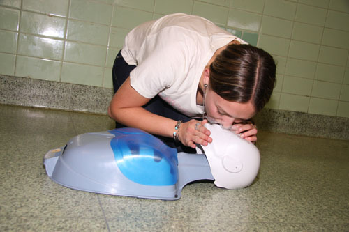 Kayla Babbush, a Kennedy sophomore, demonstrates cardiopulmonary resuscitation on a dummy.