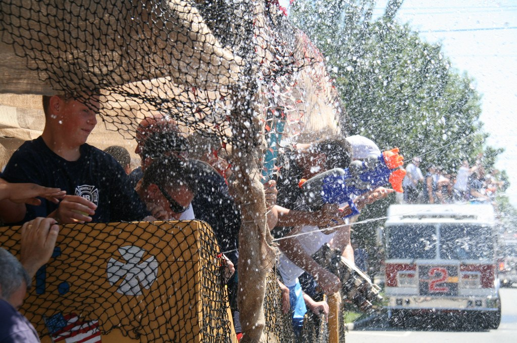 Water fight at the Stewart Manor Parade