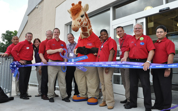 A ribbon-cutting ceremony at the Valley Stream Toys R Us store included manager Ken Farrell, with the big scissors.