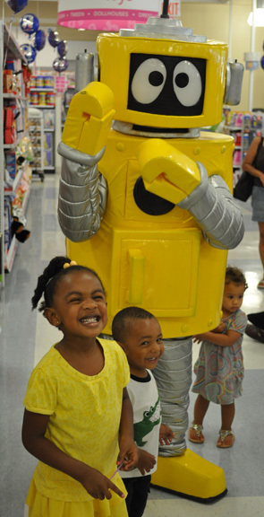 Olivia Thomas, 4, and brother Cole, 2, with Plex the robot.