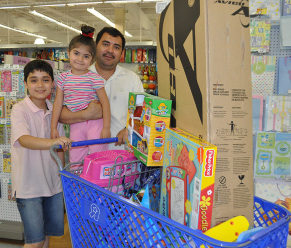 Family Kevin, Chelsea and their father Haniis Benita have a full shopping cart.