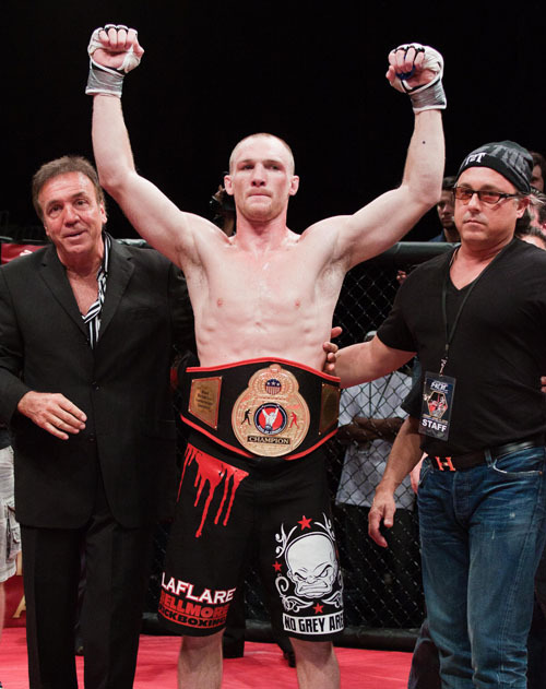 MMA promoter and Bellmore resident Lou Neglia, left, with Ring of Combat welterweight champion Ryan LaFlare, center.