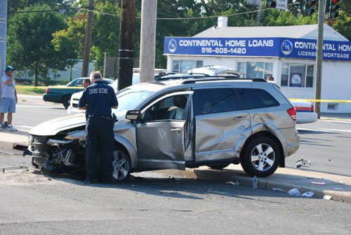 Police investigated a fatal two-car collision in East Meadow on Monday.