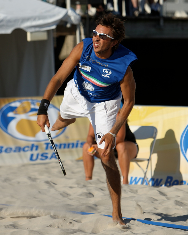 Matteo Marighela competing in the International Beach Tennis championship at Riverside Boulevard last Sunday. Marighela and his teammate, Alex Mingozzi, both of Italy, won the Men's Pro Division title.