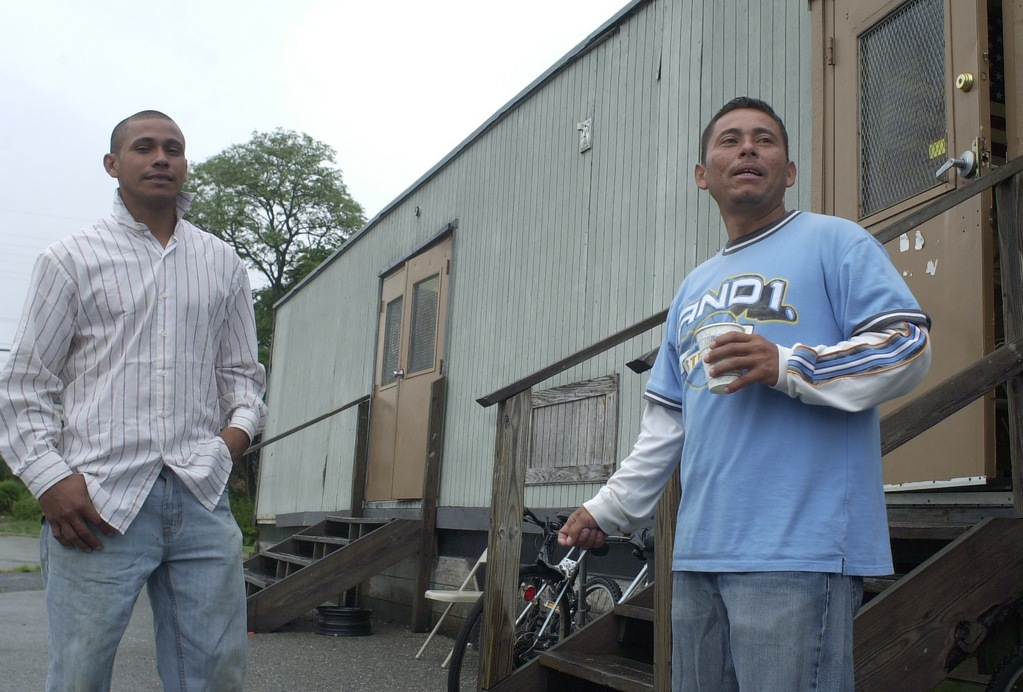 Laborers waited for jobs outside the trailer last week.
