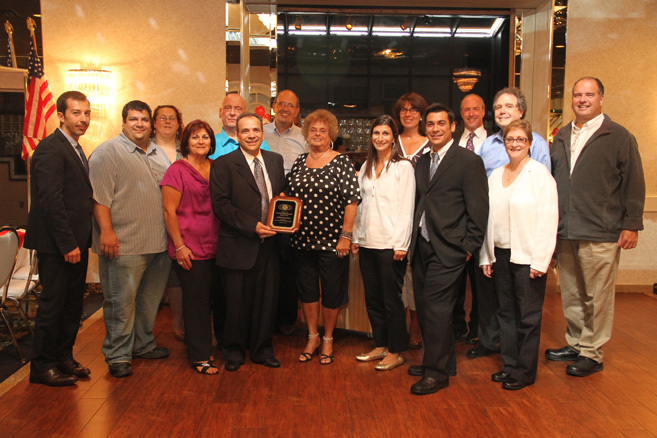 The West Hempstead Kiwanis Club presented Antonino Scolieri, the founder of A&S Bagels, and his family with a plaque.