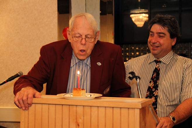 Kiwanis Secretary Bob Smith celebrated his 87th birthday, blowing out a candle presented by Ed Freeberg.